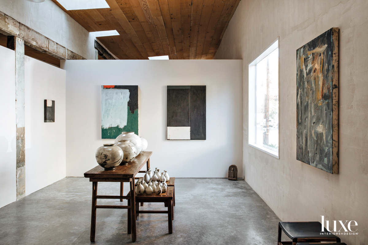 A shot of the interior of Hugomento, paintings hang on white walls.