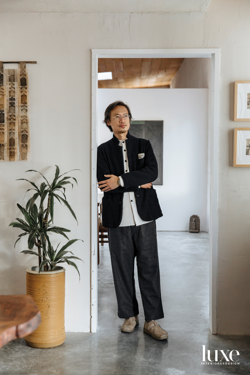 Hugo Lai stands in his gallery.