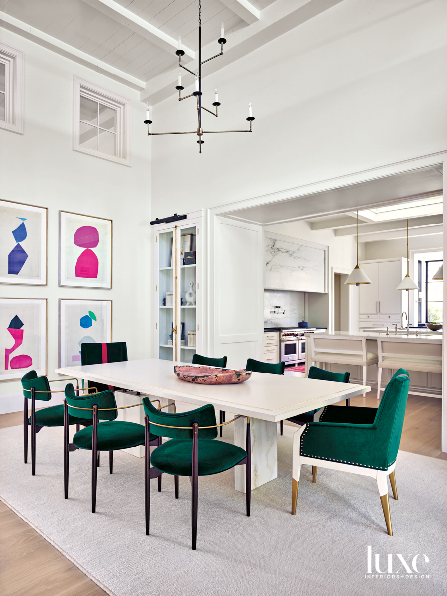 Bright dining room with emerald...