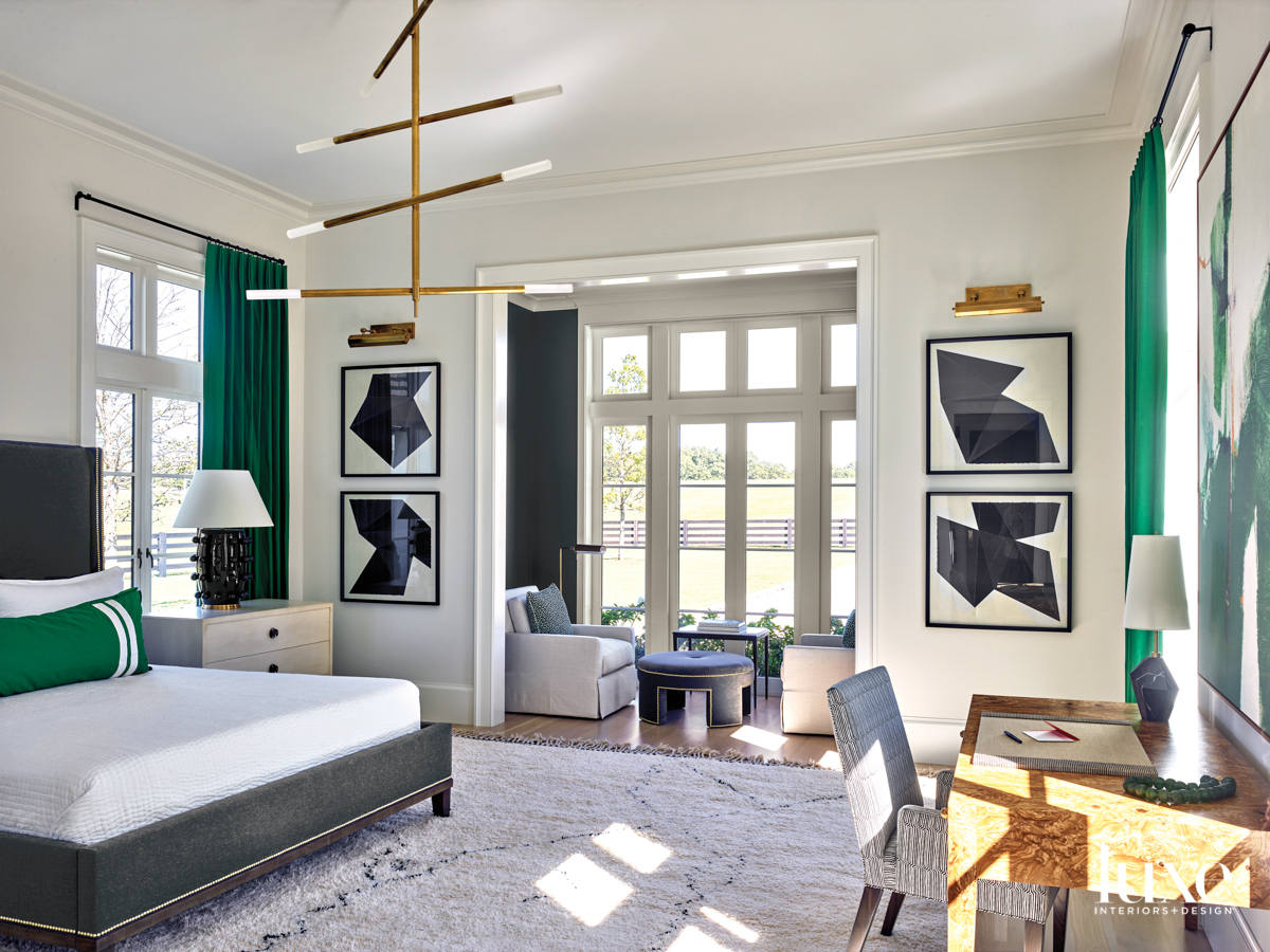 Contemporary bedroom with abstract black...