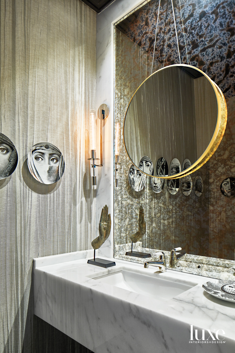 Glamorous powder room with striated...