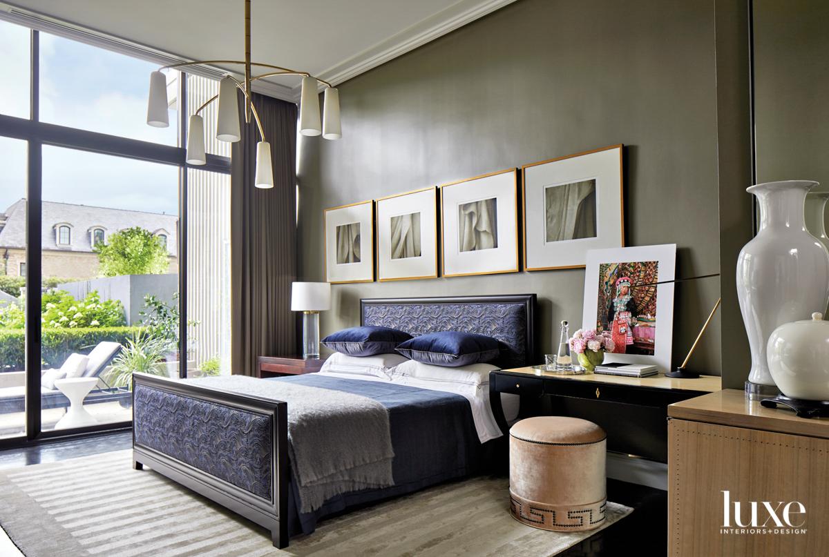 Sleek bedroom with navy upholstered...