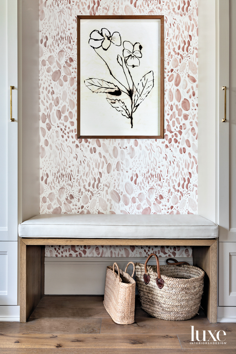 Chic mudroom with wallpaper.
