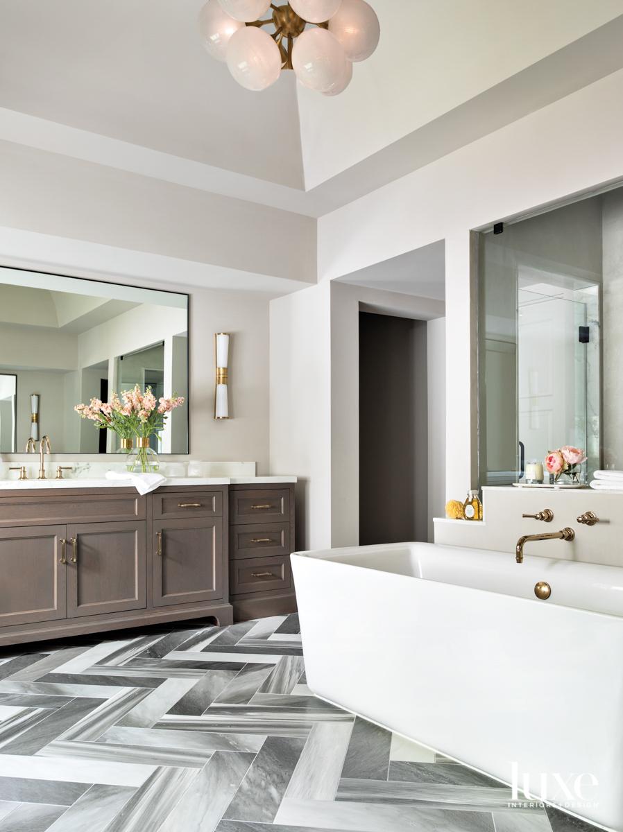 Main bathroom featuring Ann Sacks...