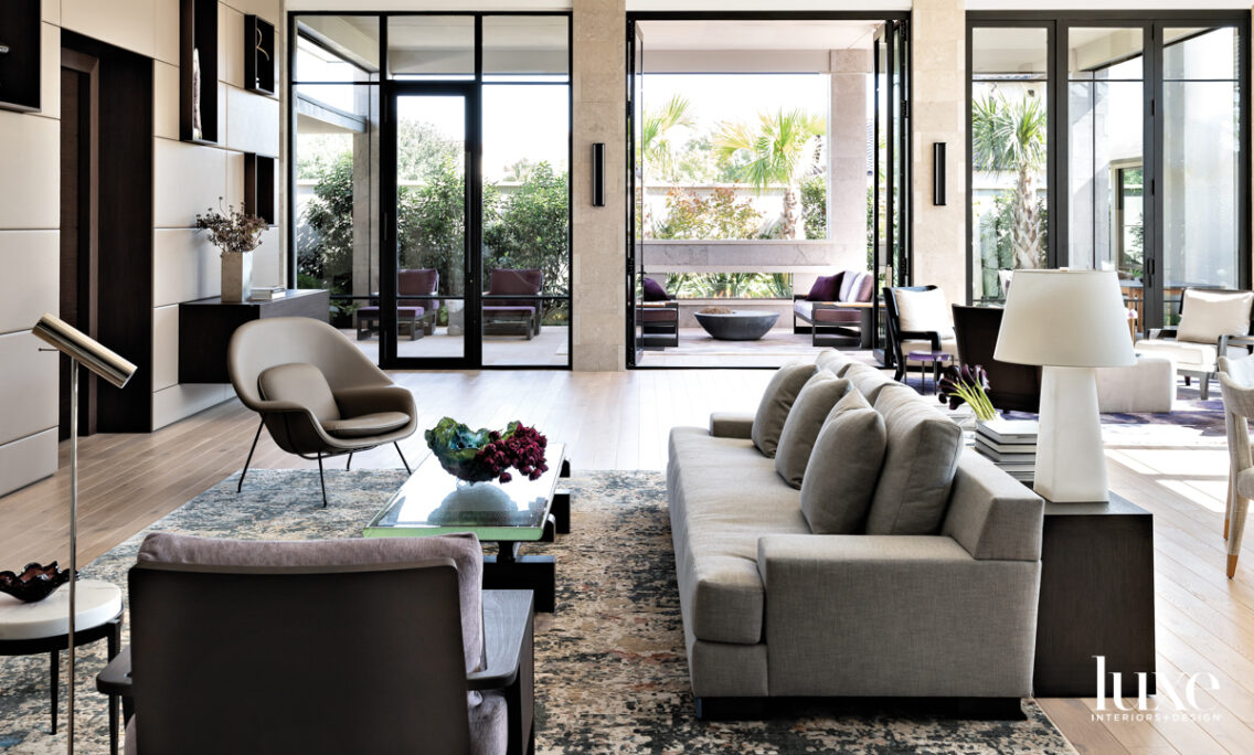 Family area with several seating arrangements overlooking an outdoor terrace.