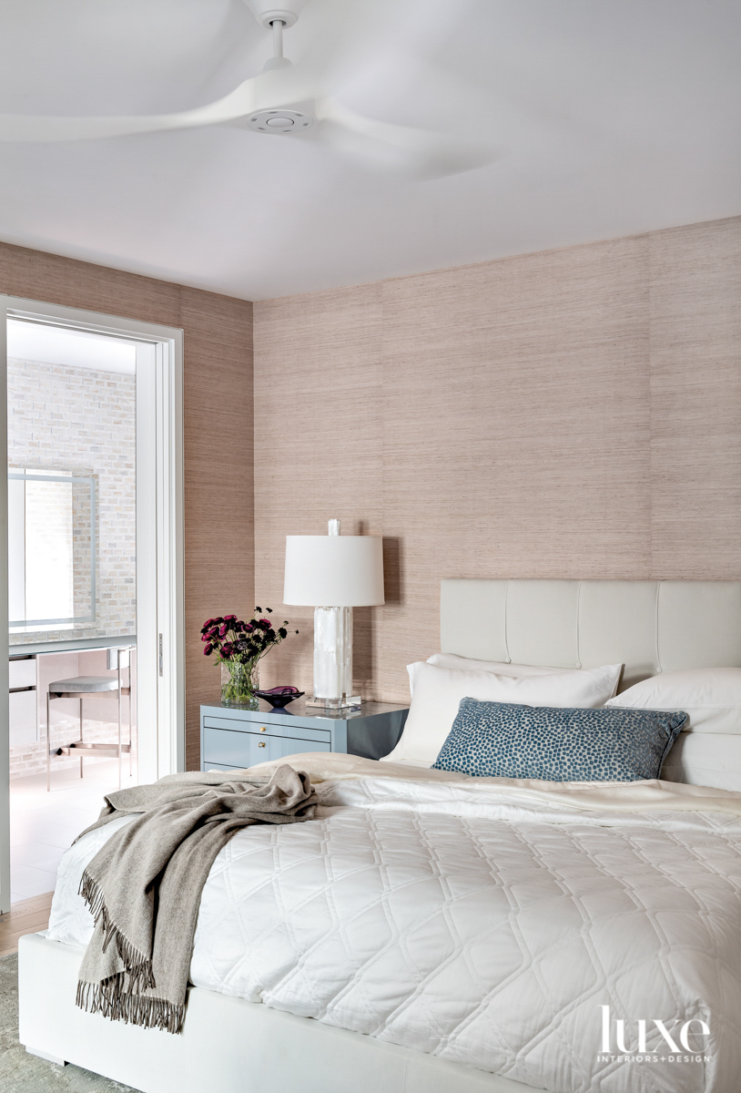 Main bedroom with subtle grasscloth...