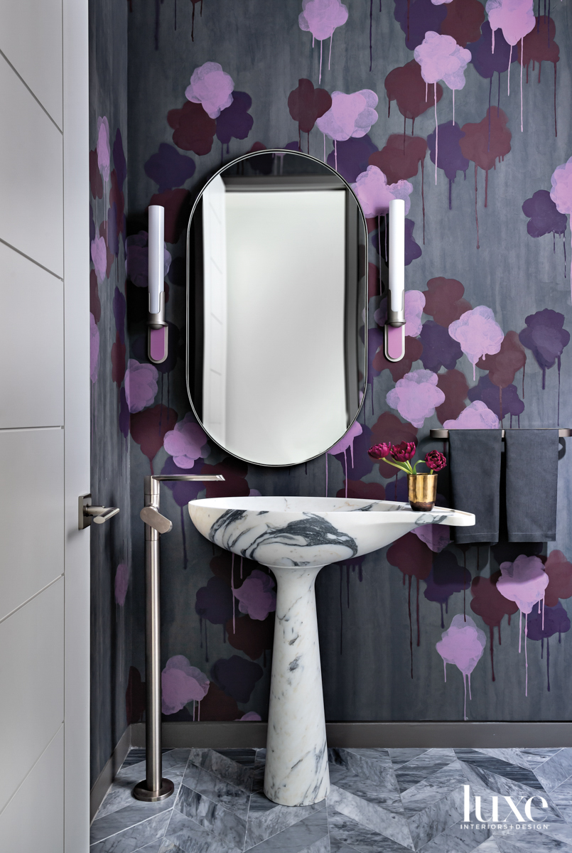 Powder bathroom with statement wallpaper...