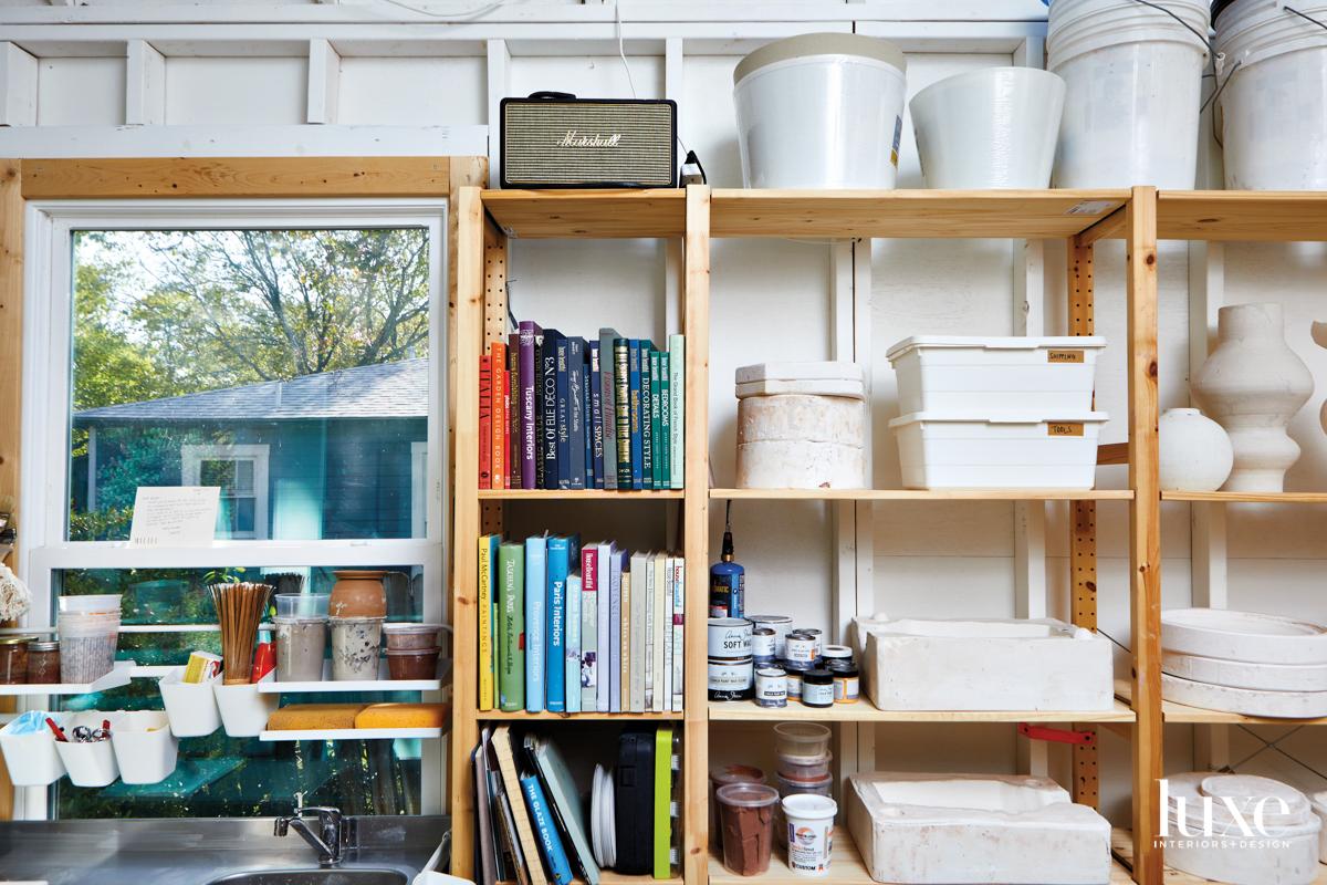 Items stored on shelves in ceramicist Megan Leihgeber's Austin Studio.