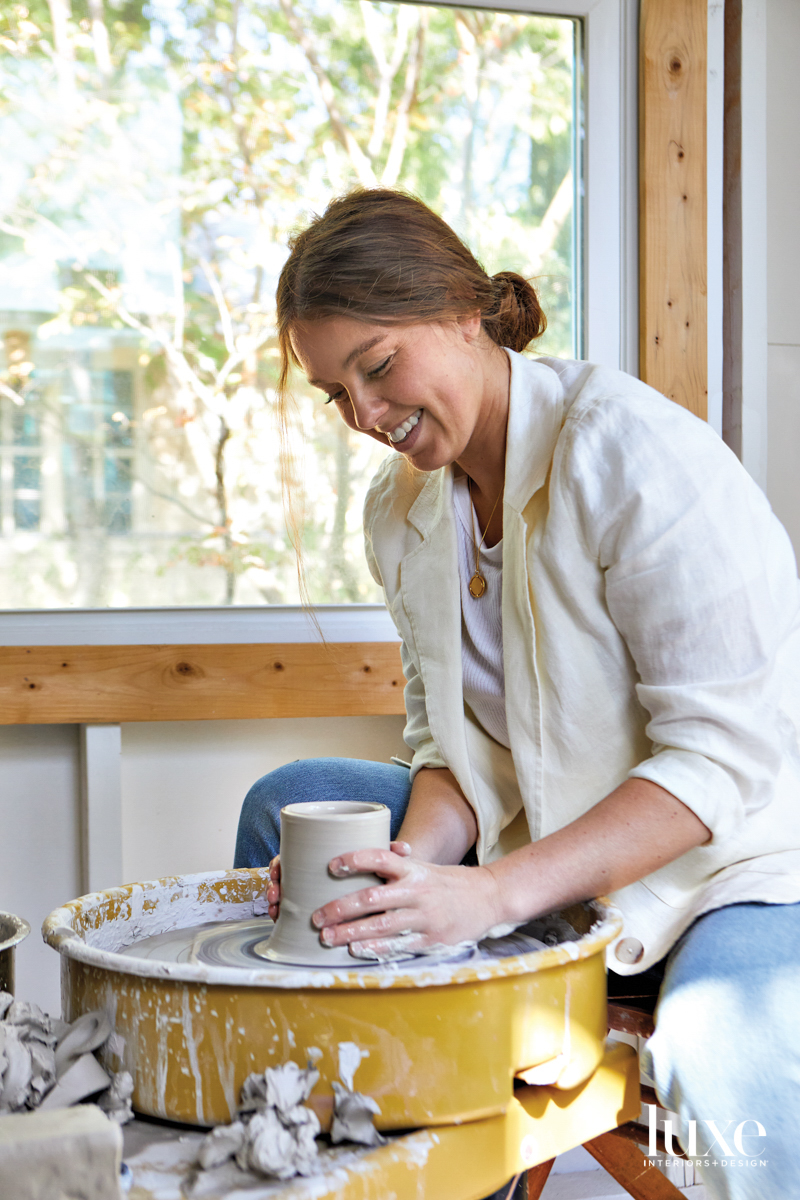 Ceramicist Megan Leihgeber throws on the wheel in her Austin Studio.