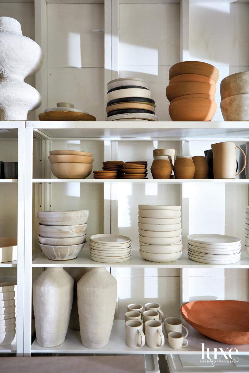 Stacks of pottery in ceramicist Megan Leihgeber's studio.