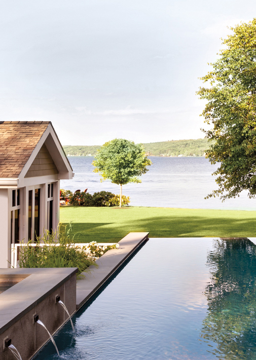 lake house exterior with pool