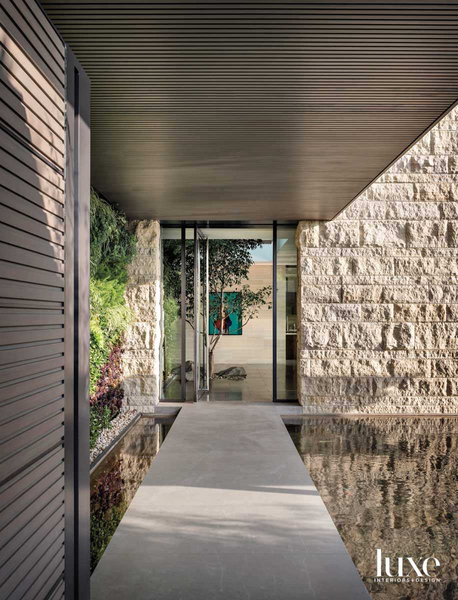 Covered concrete walkway leading to...