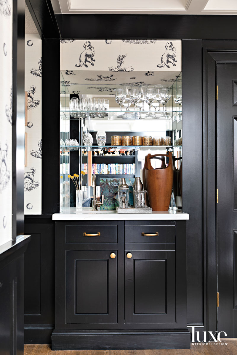 Bar area with black-painted cabinetry...