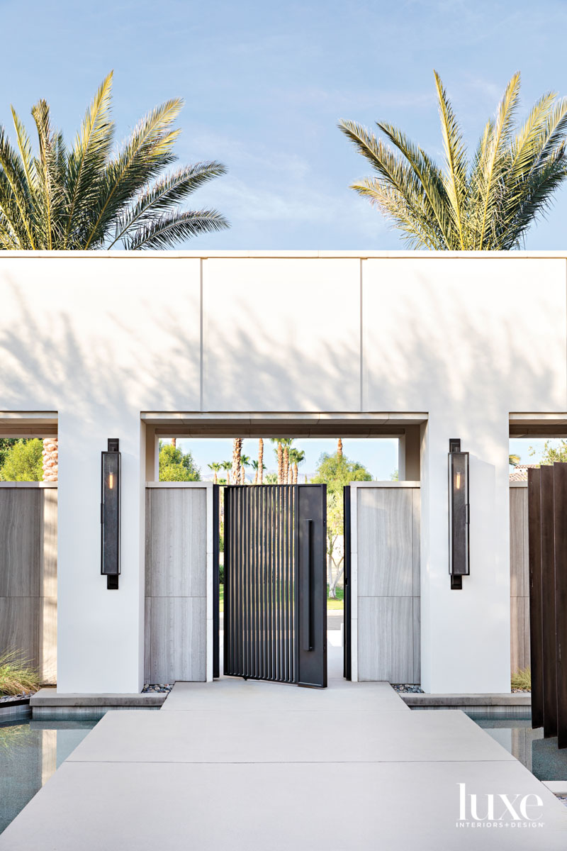 Entry to house featuring a...