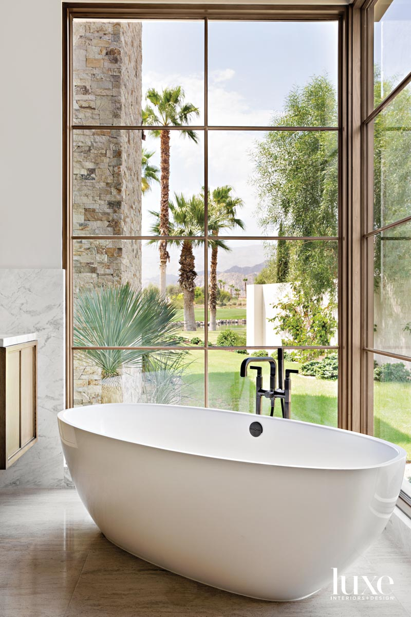 Freestanding bathtub positioned at a...