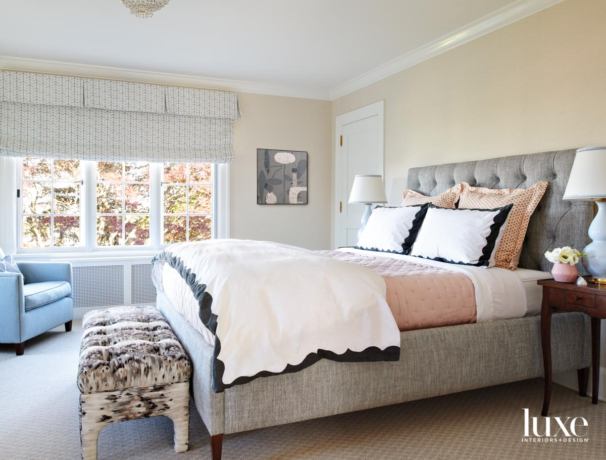 Main bedroom facing tufted bed...