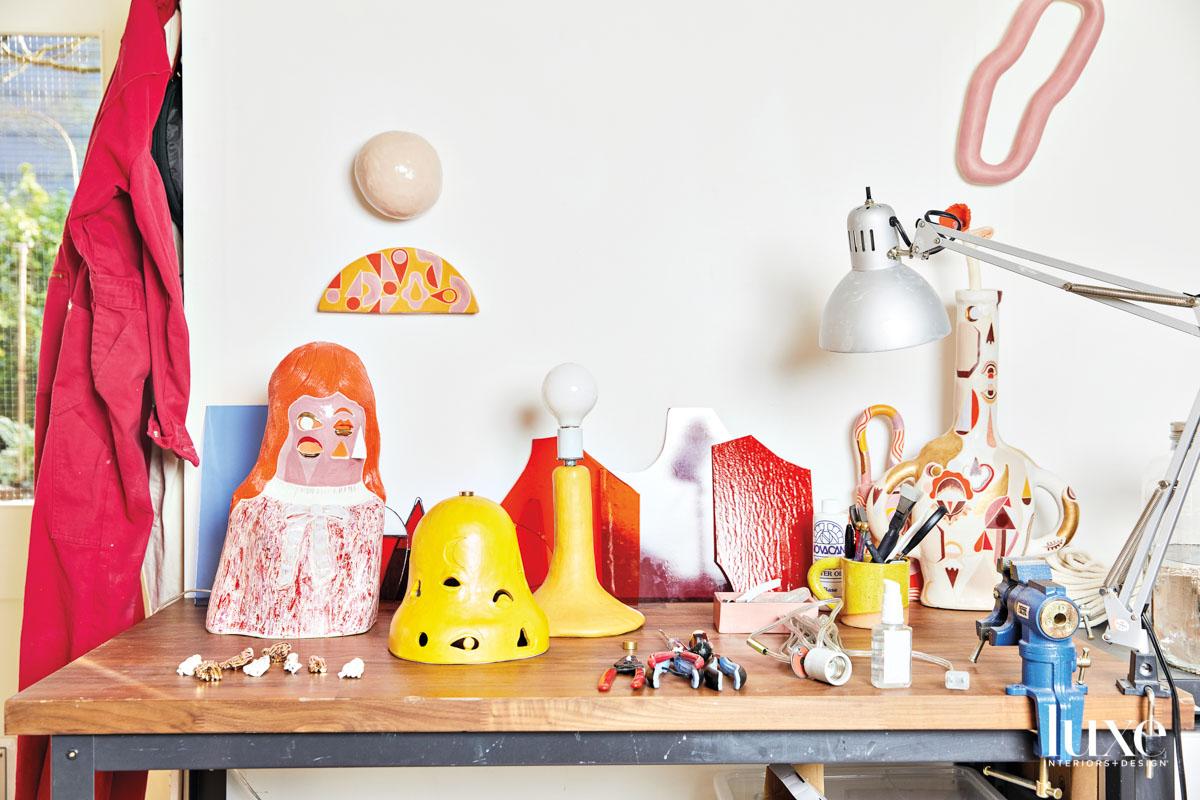 studio work table with ceramic pieces