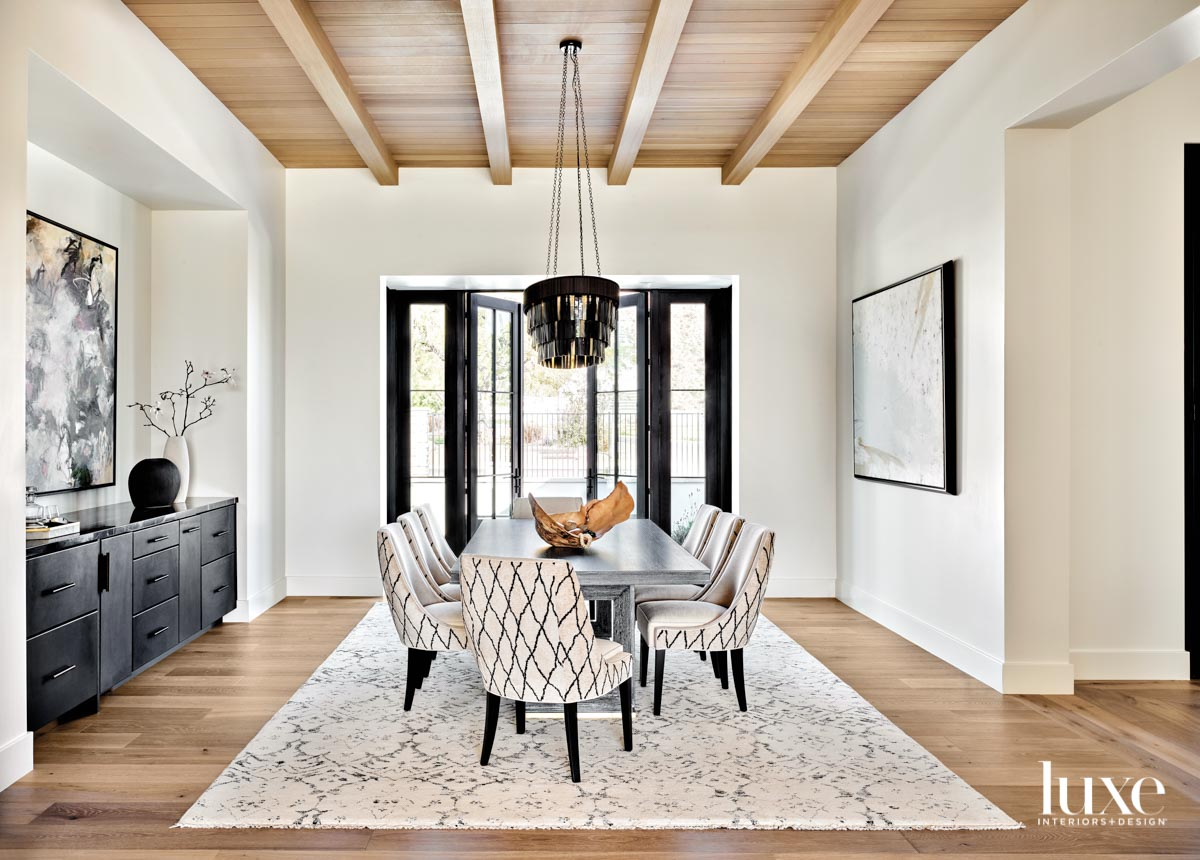 A dining room with a...
