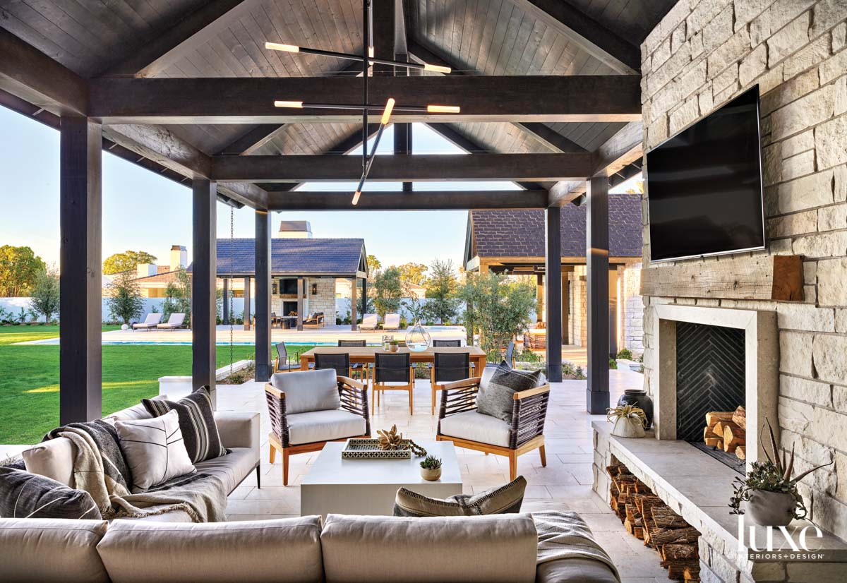 An outdoor fireplace pavilion with...