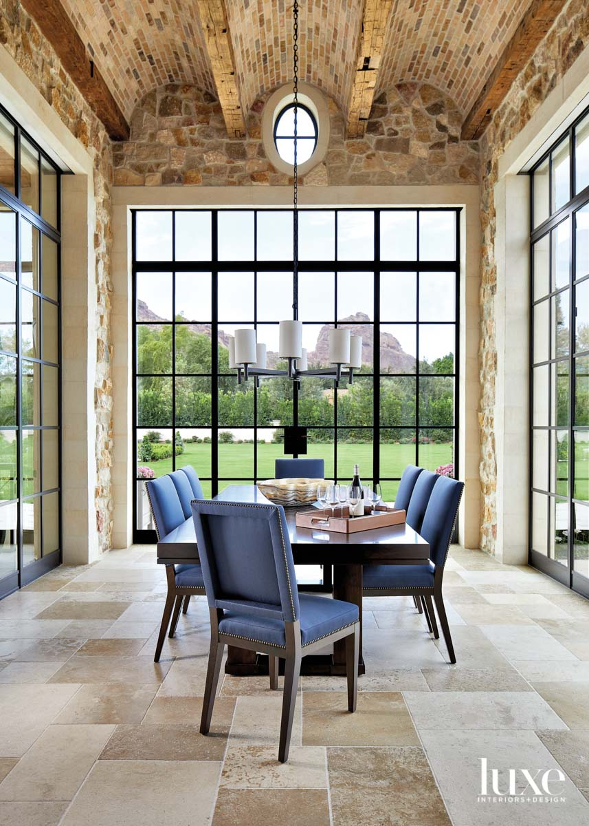 A dining room with steel-and-glass...