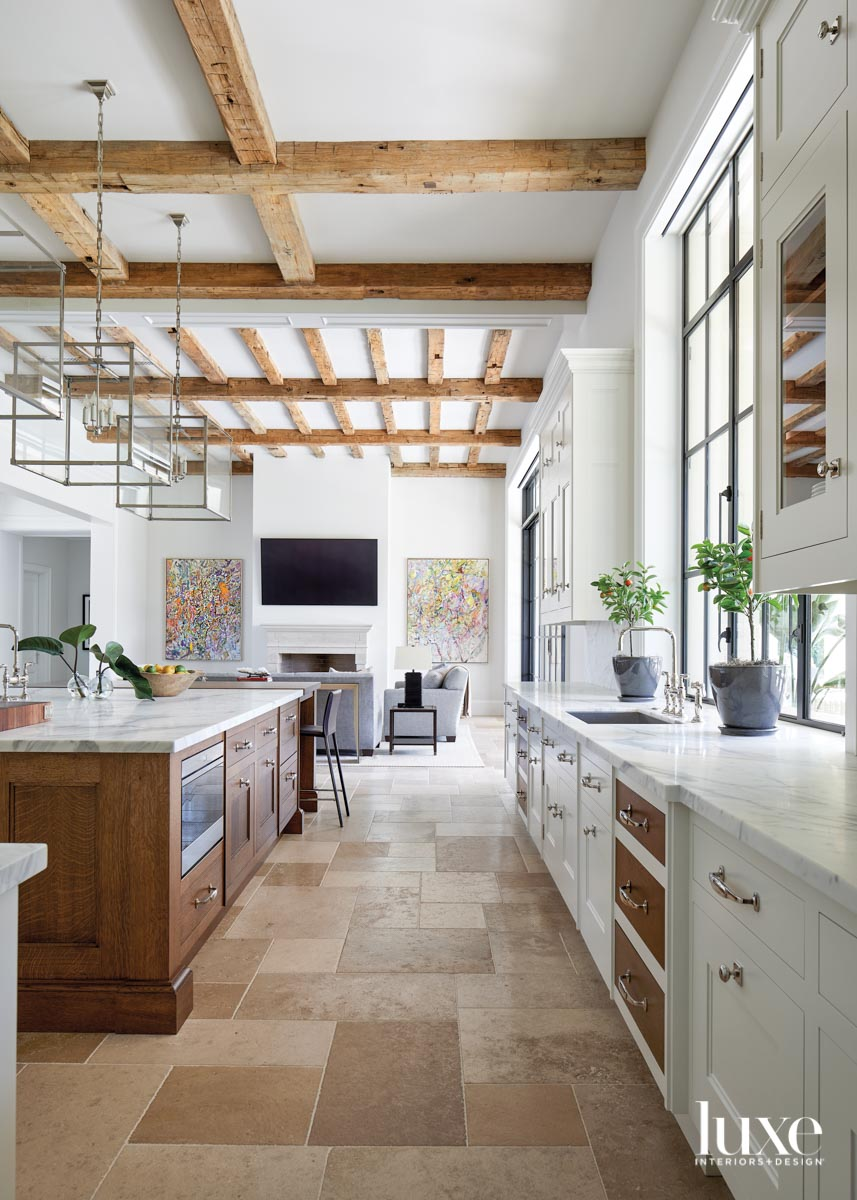 A kitchen with white-and-brown cabinetry...