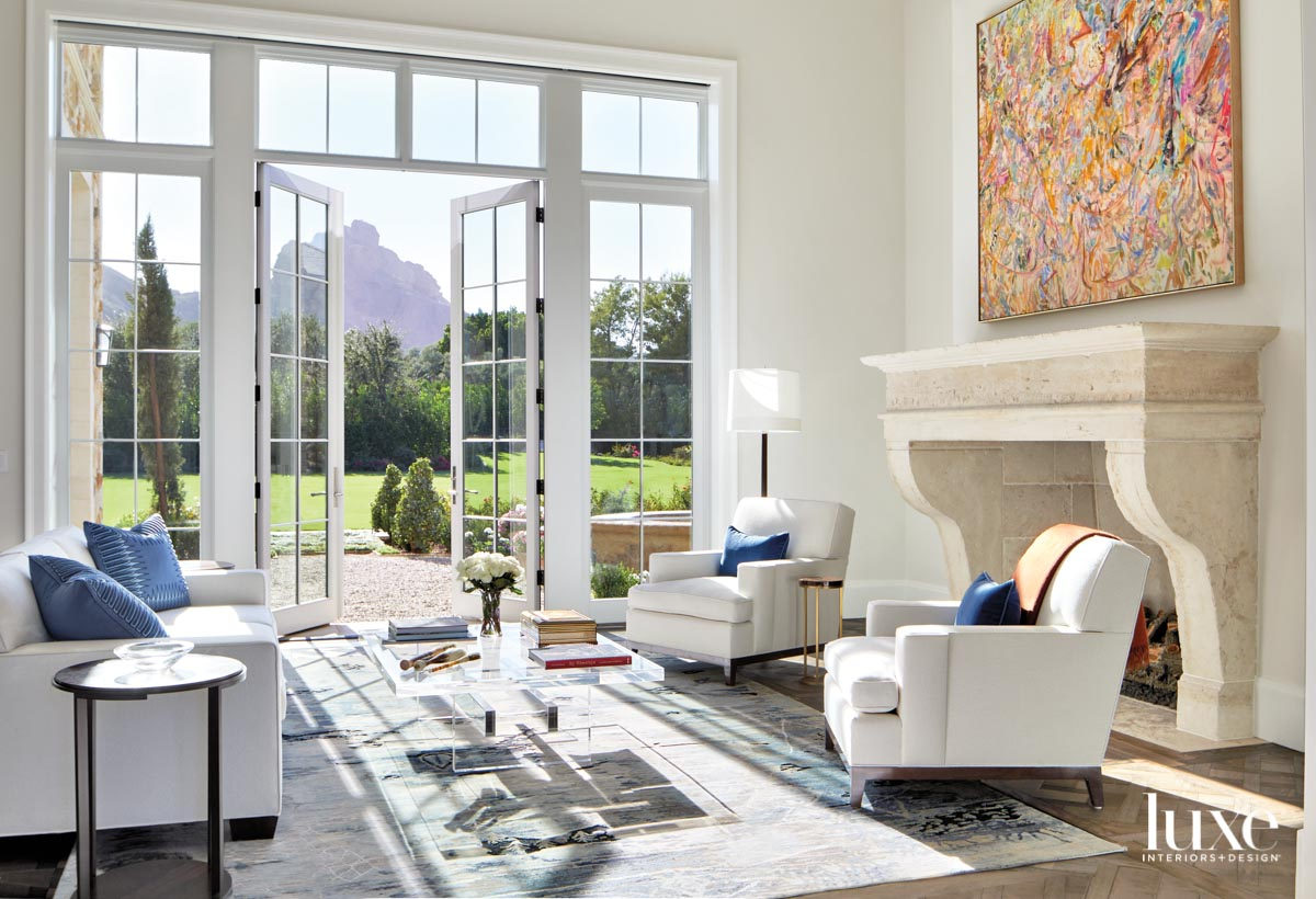 A living room a white...