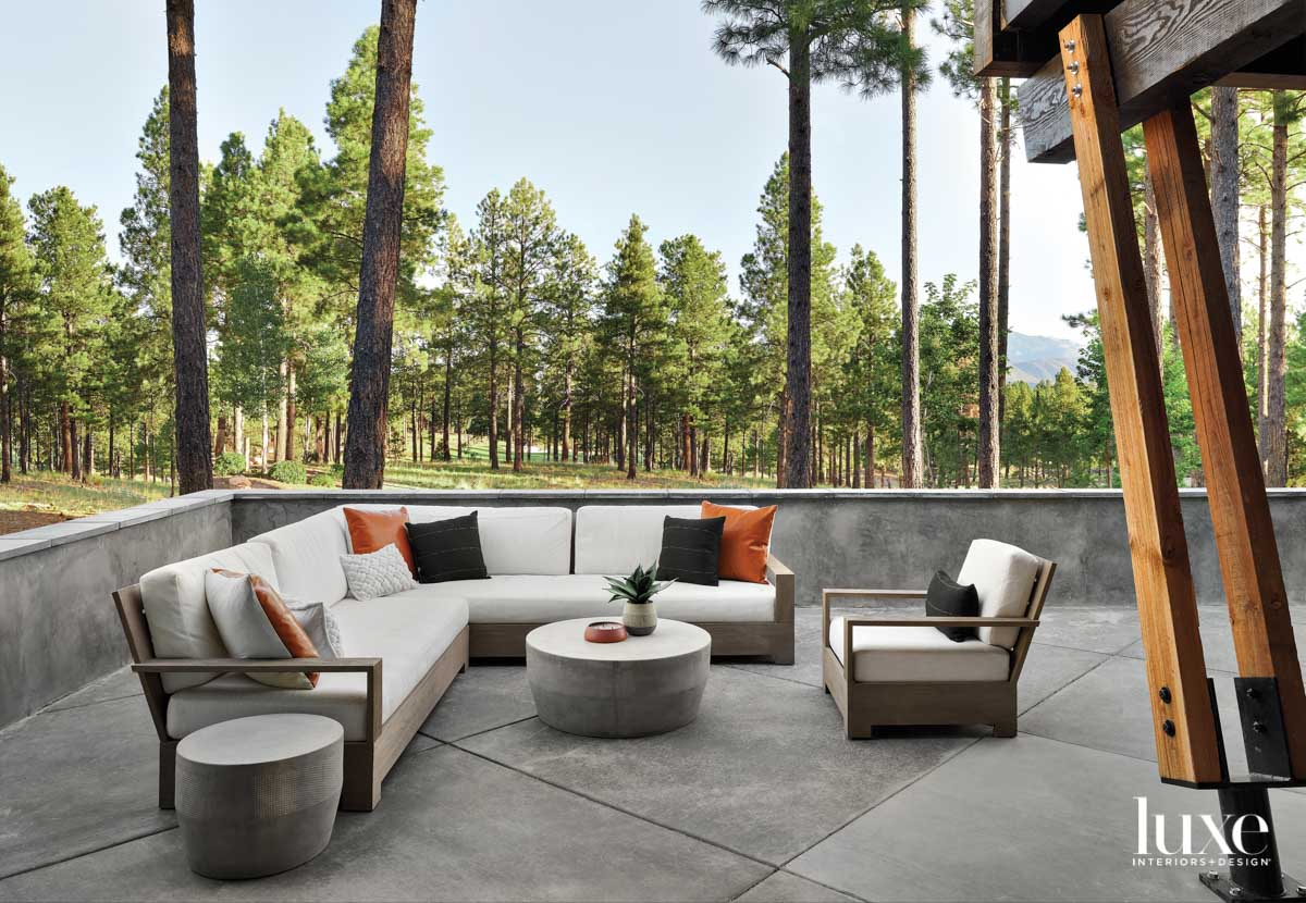 A patio with a chair,...