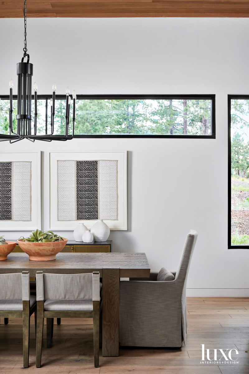 A dining room with gray...