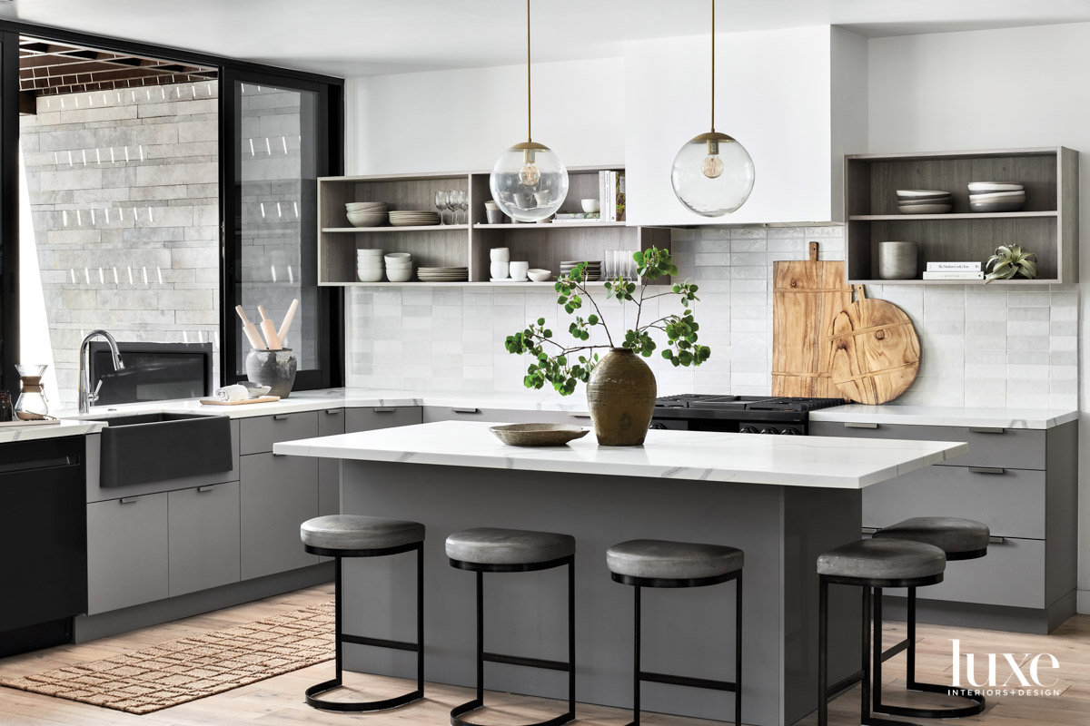 A kitchen with white subway...