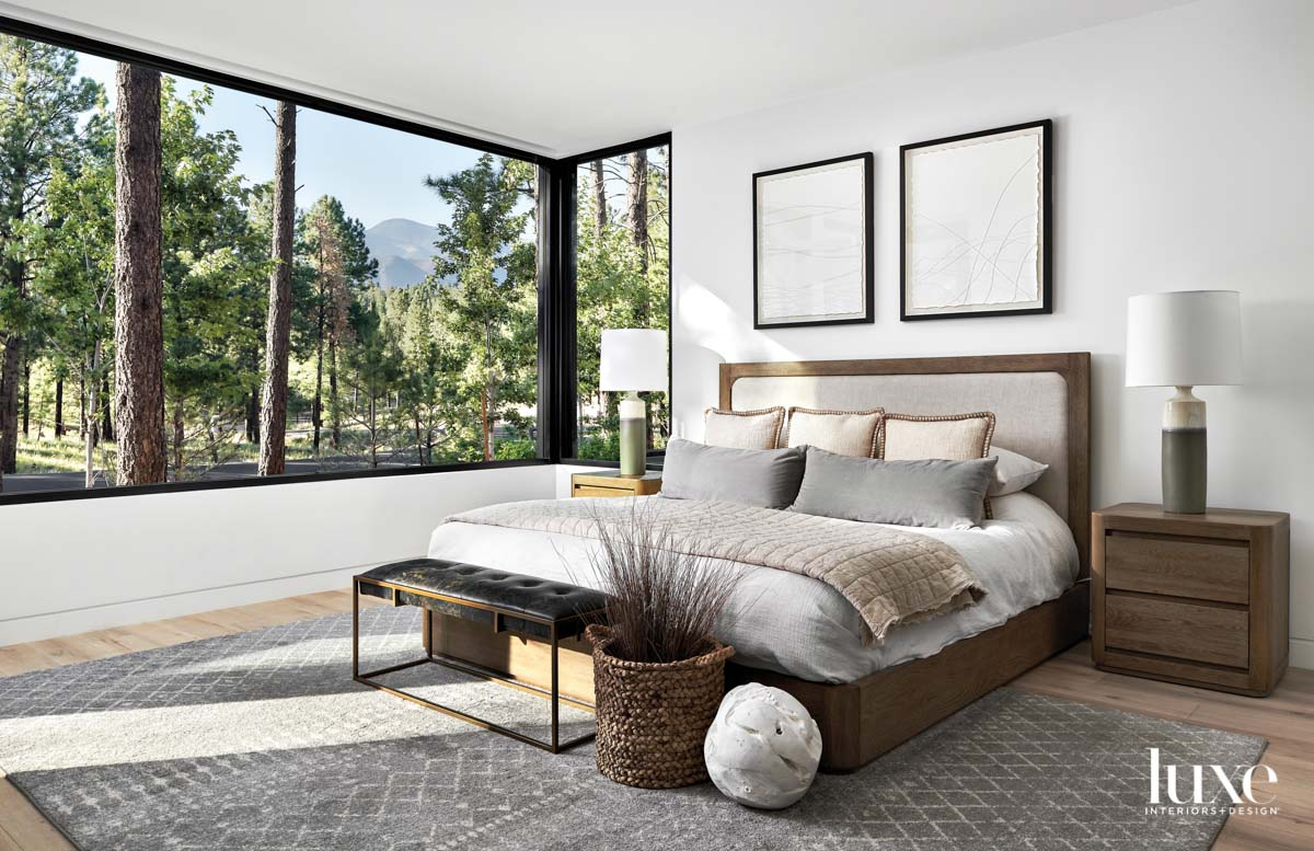 A white bedroom with wood...