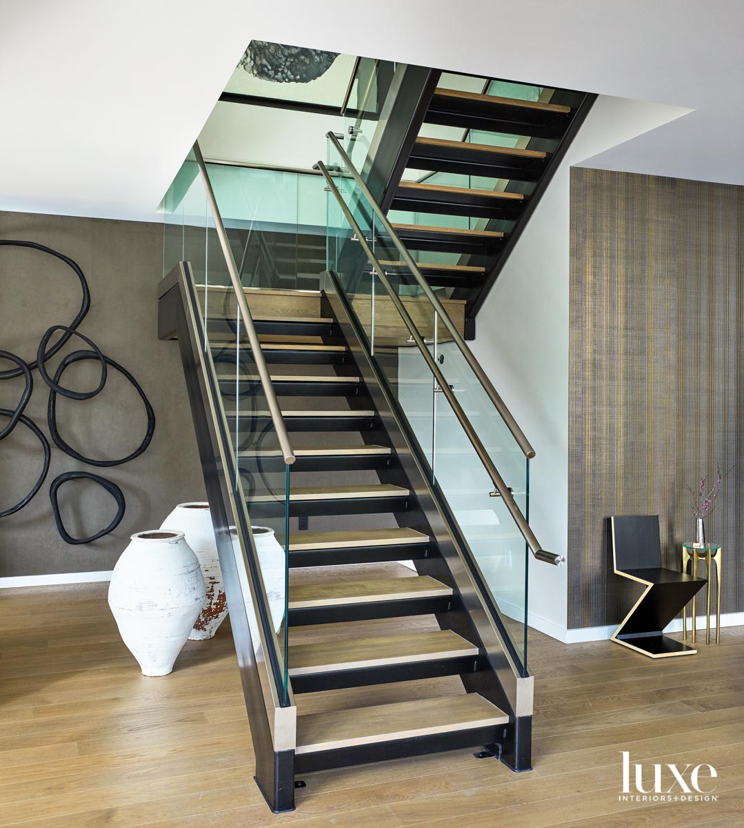 A glass staircase. Behind it...