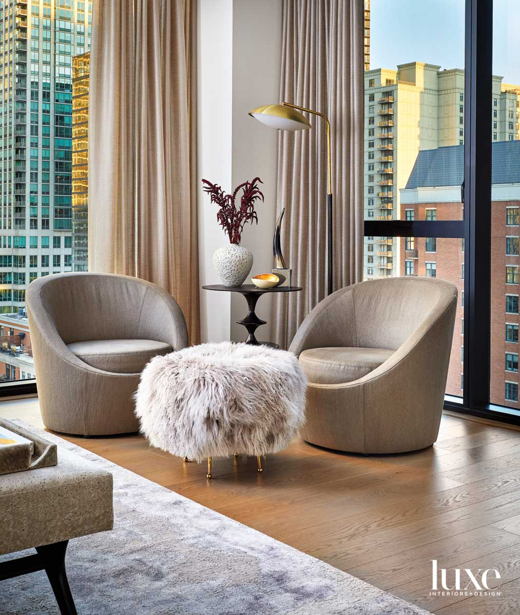 Two swivel chairs with a...
