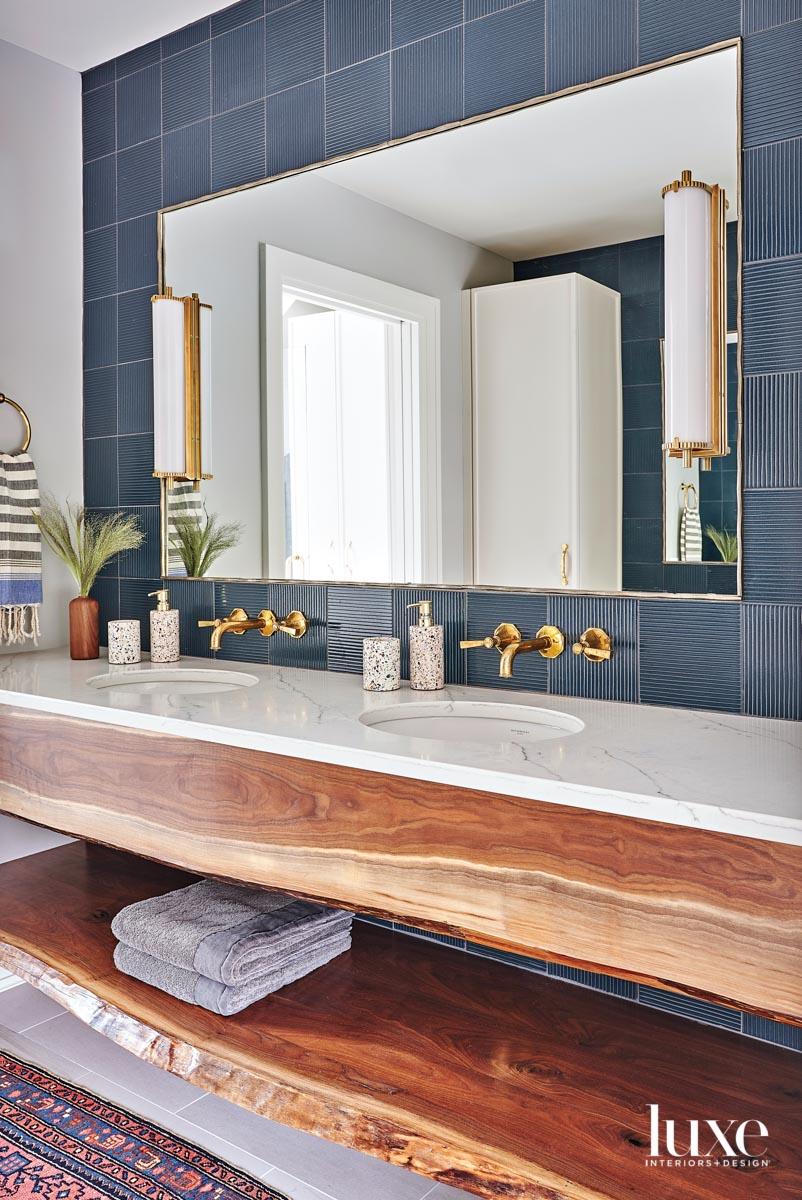 A bathroom with a live-edge...