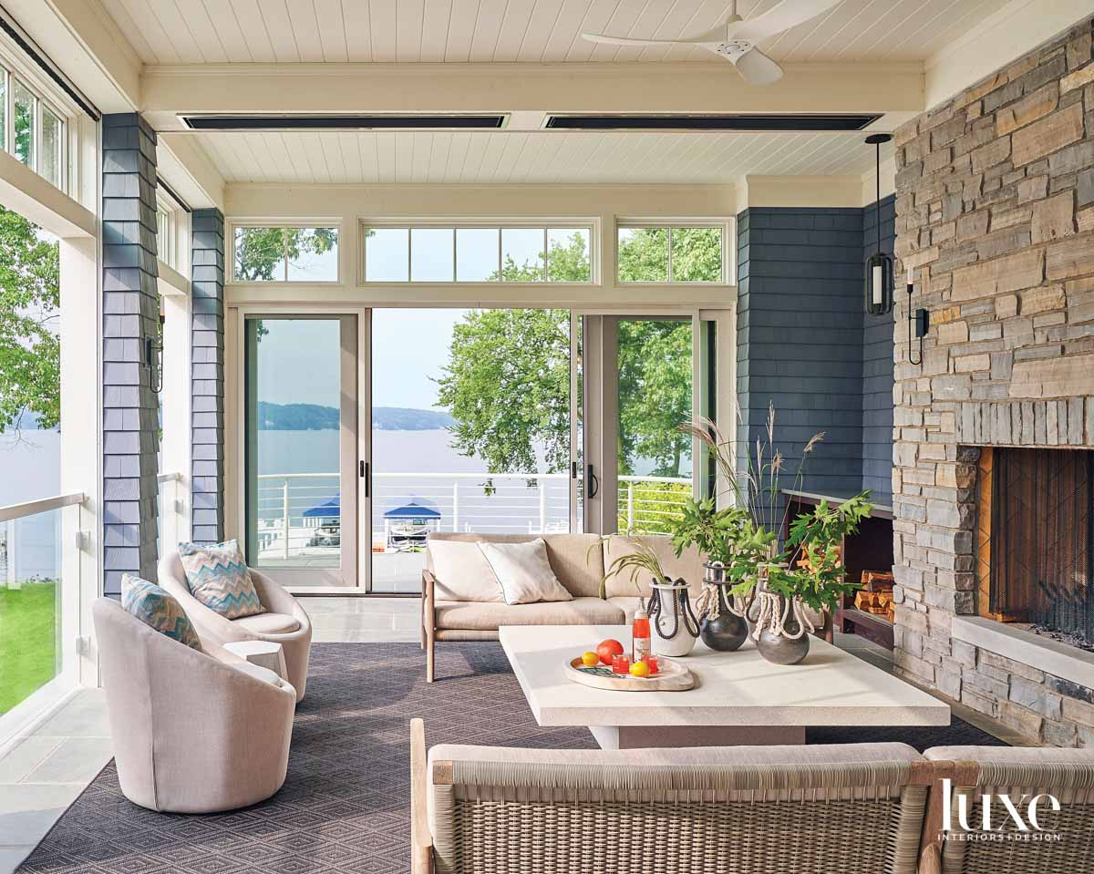 A screened in porch with...