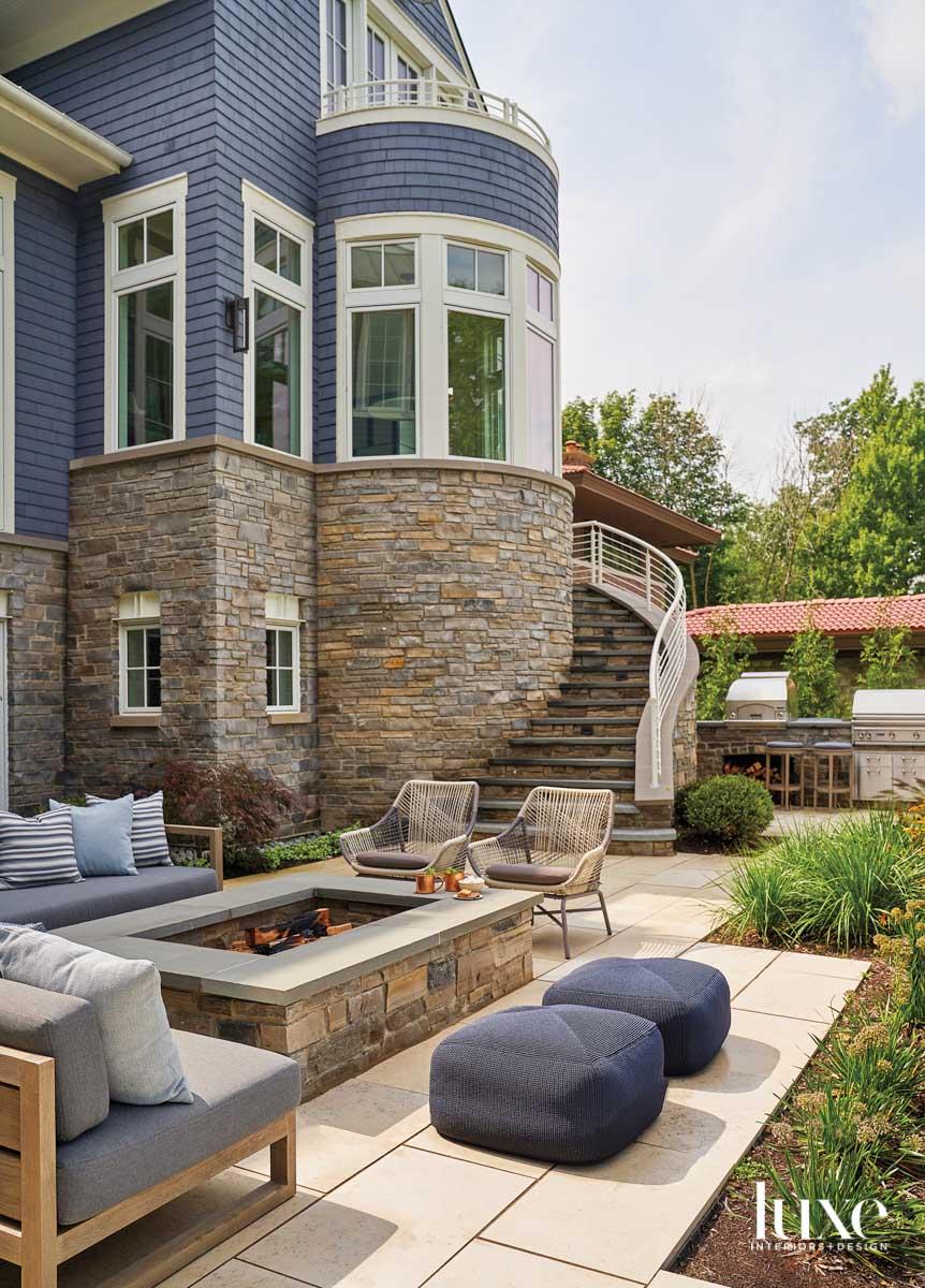 A backyard patio with a...