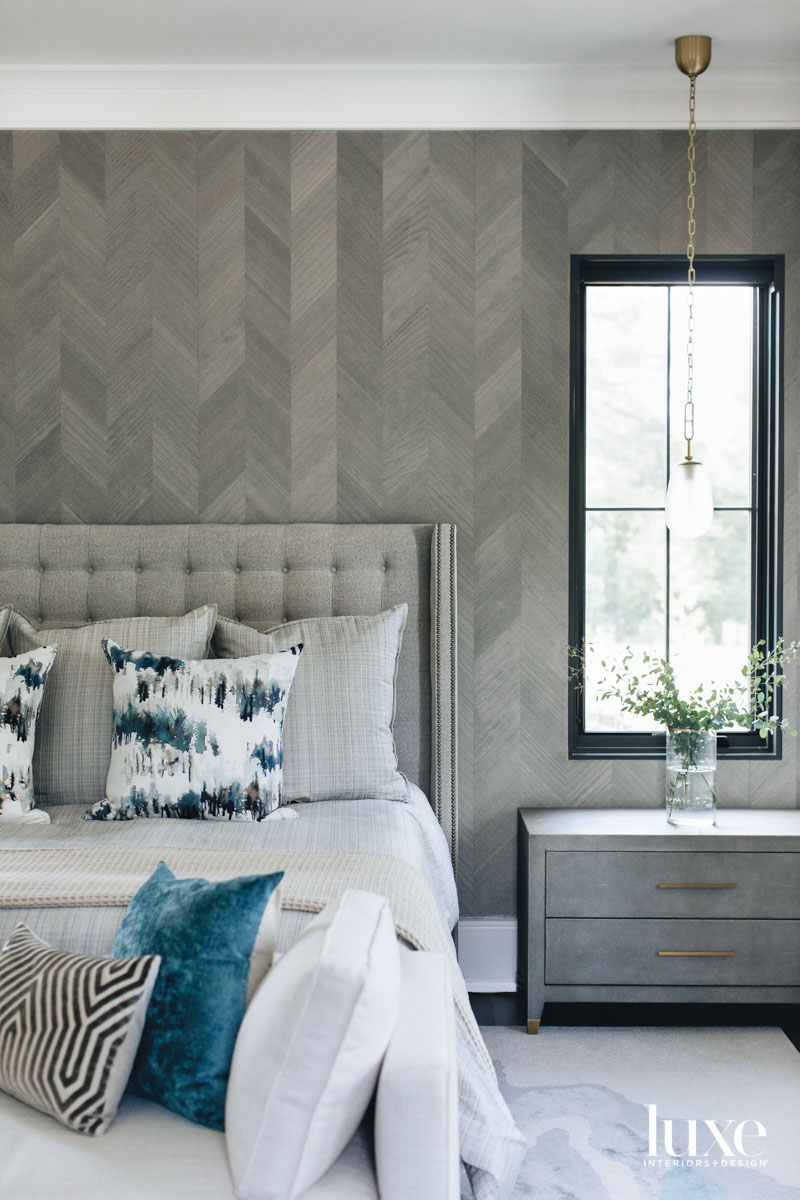 A gray bedroom with chevron...