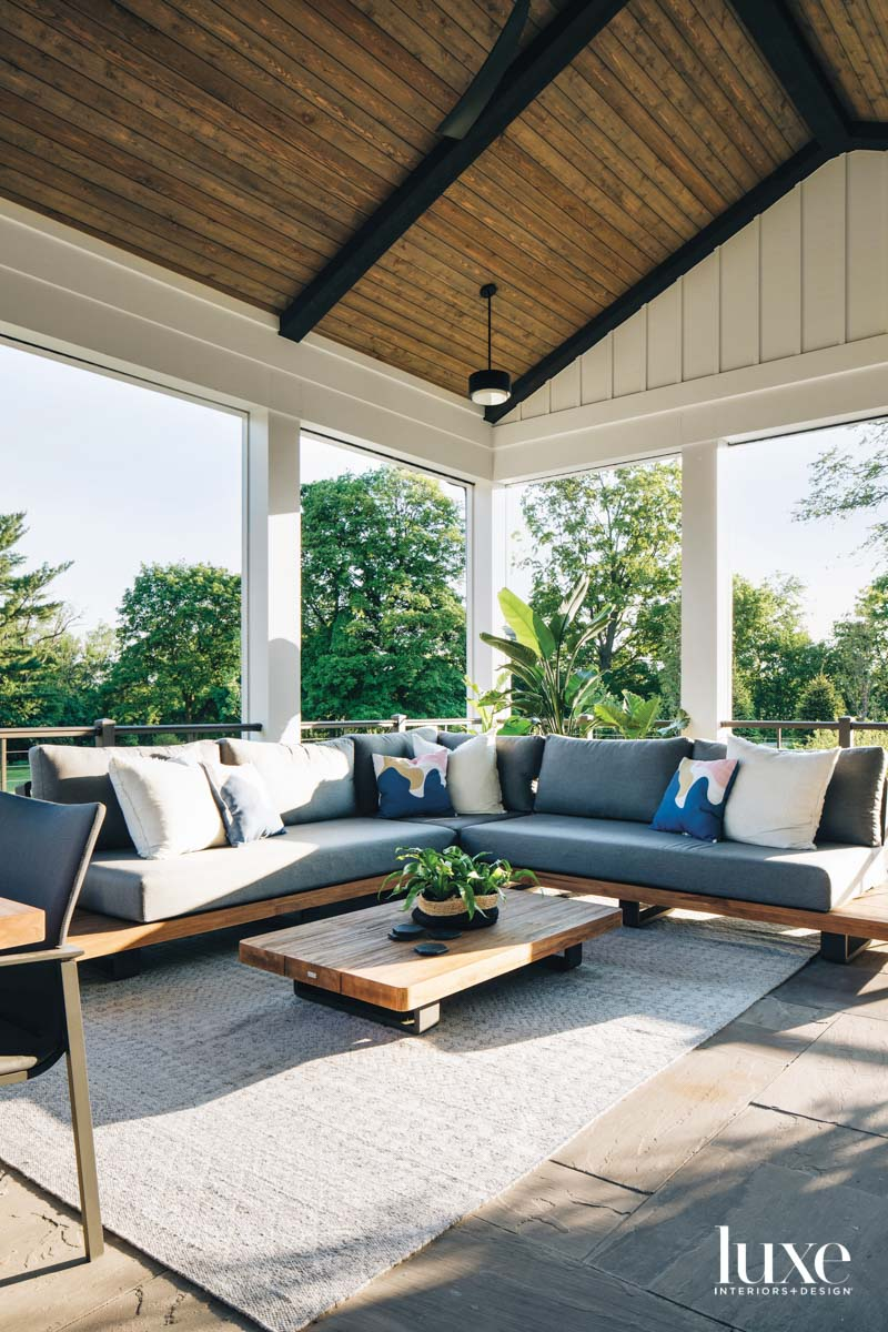 A covered patio with a...