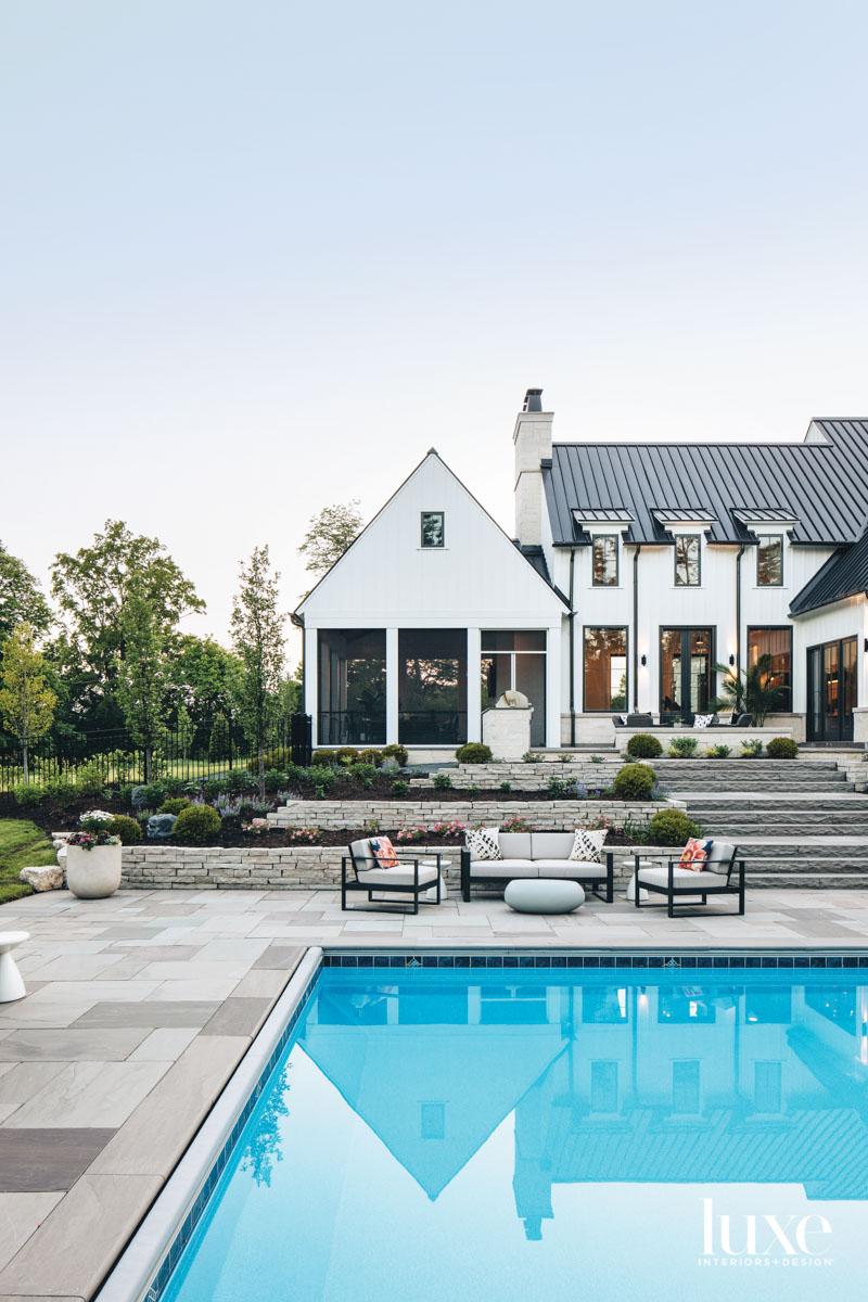 farmhouse exterior with terraced patio...