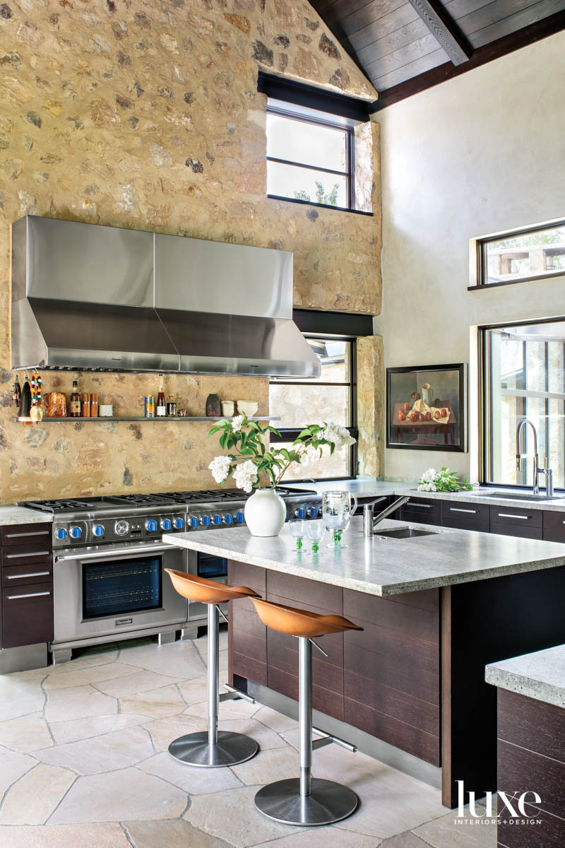 A large kitchen has stone...