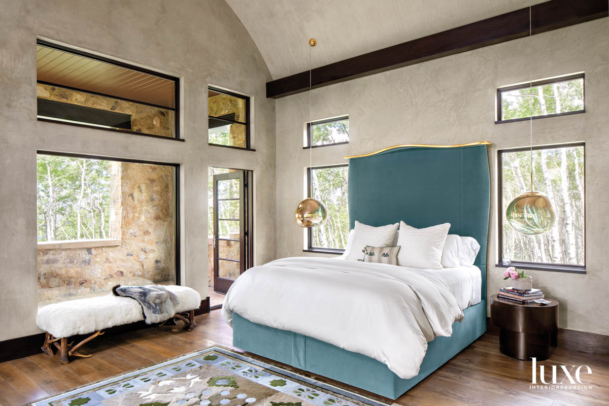 A bed with teal upholstery...