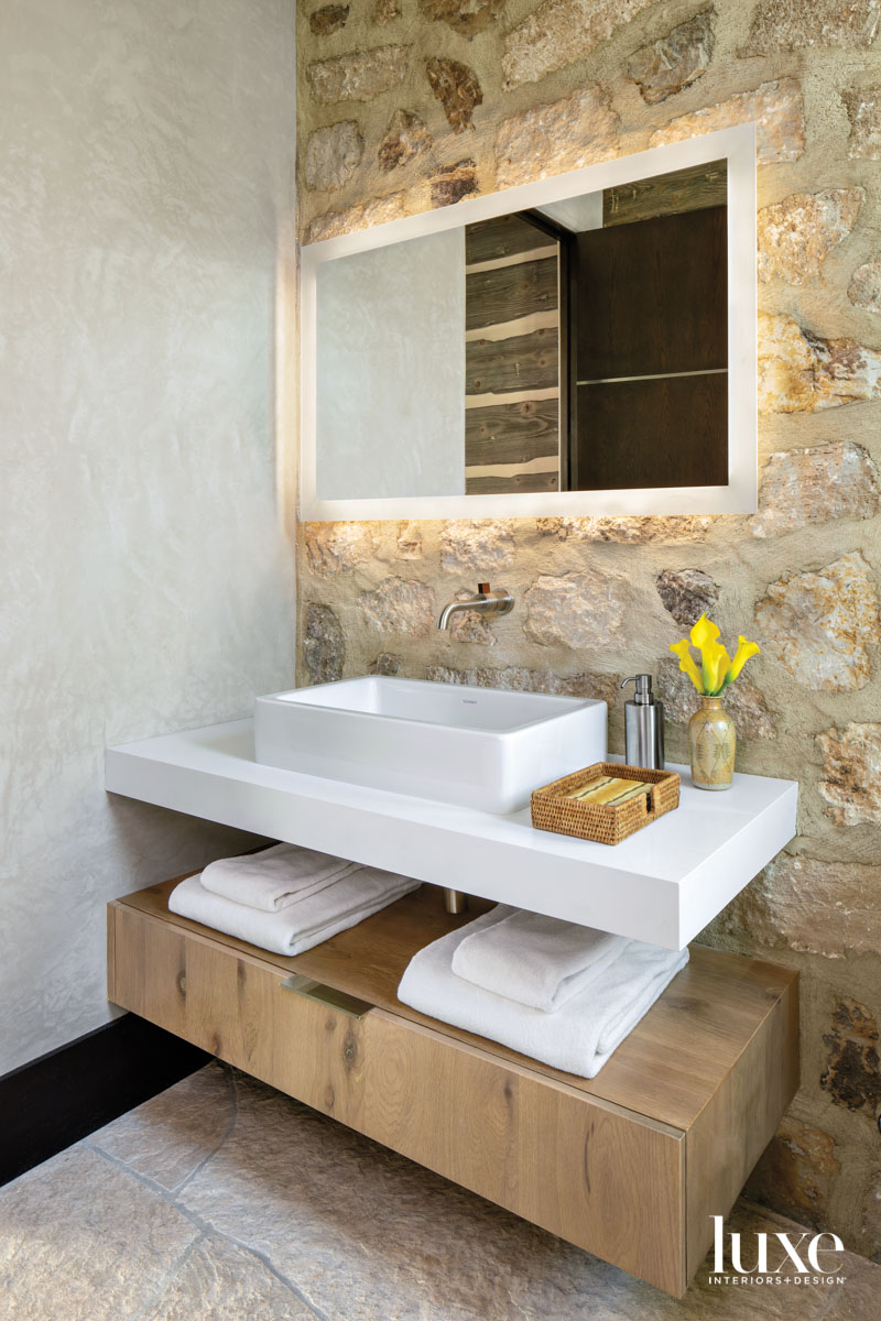 The powder room incorporates sleek...