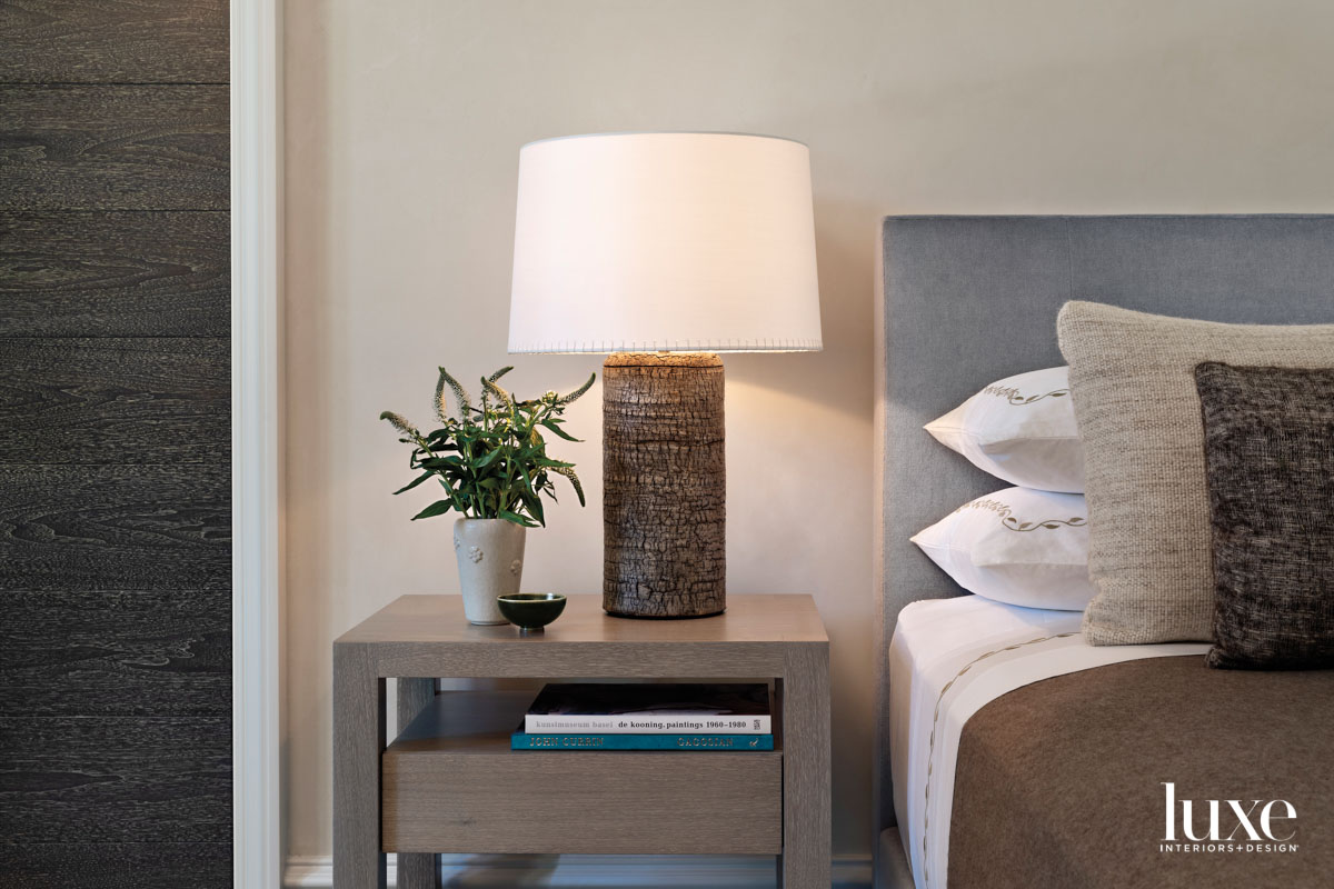 A textured ceramic lamp is...