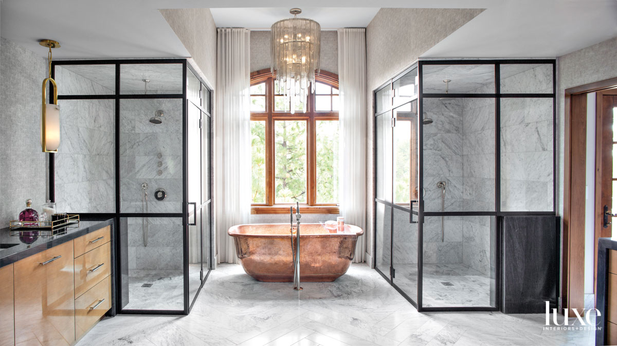The primary bathroom features a gleaming copper tub.