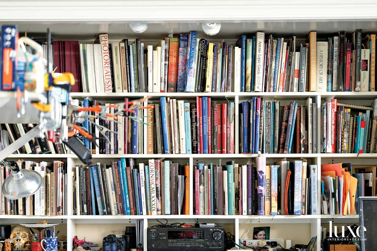 bookshelf lined with art books