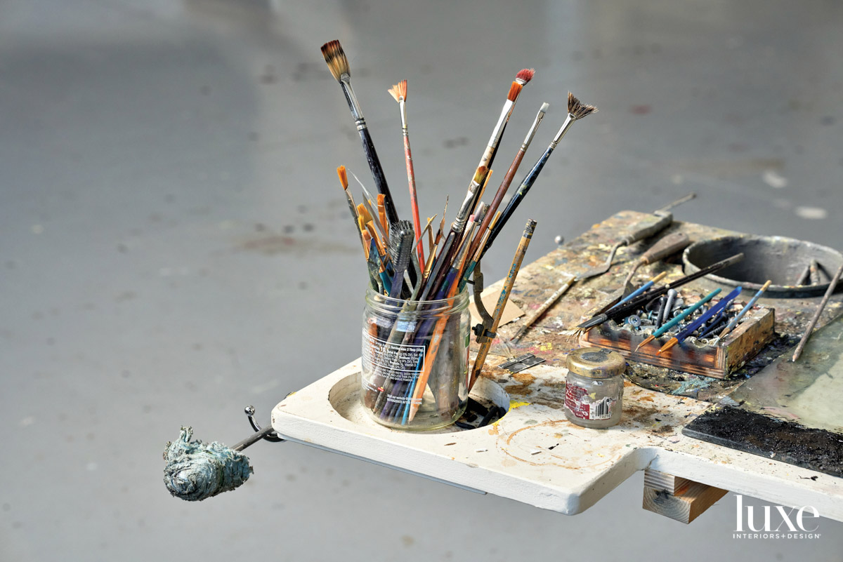 glass jar with paintbrushes