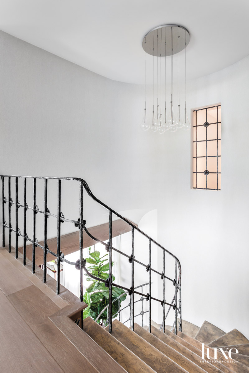 wood staircase with metal-iron railing...
