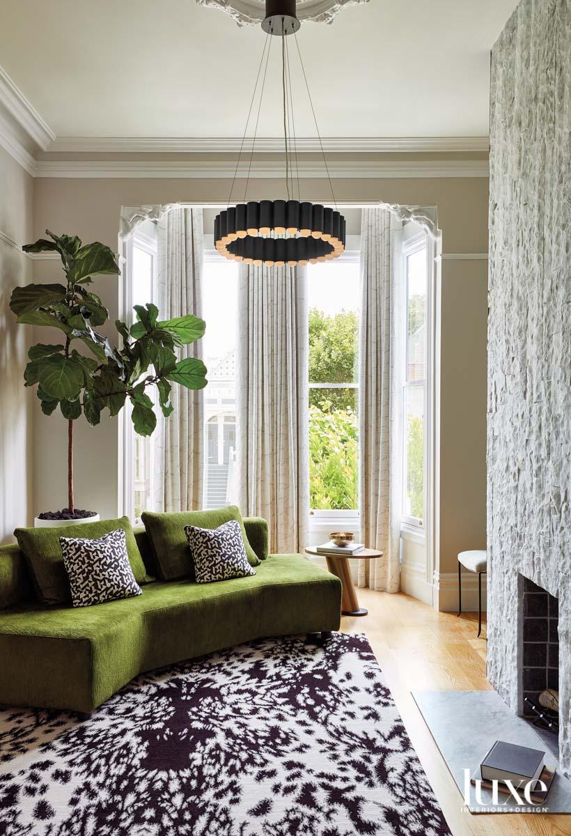 A green, angular sofa sits...