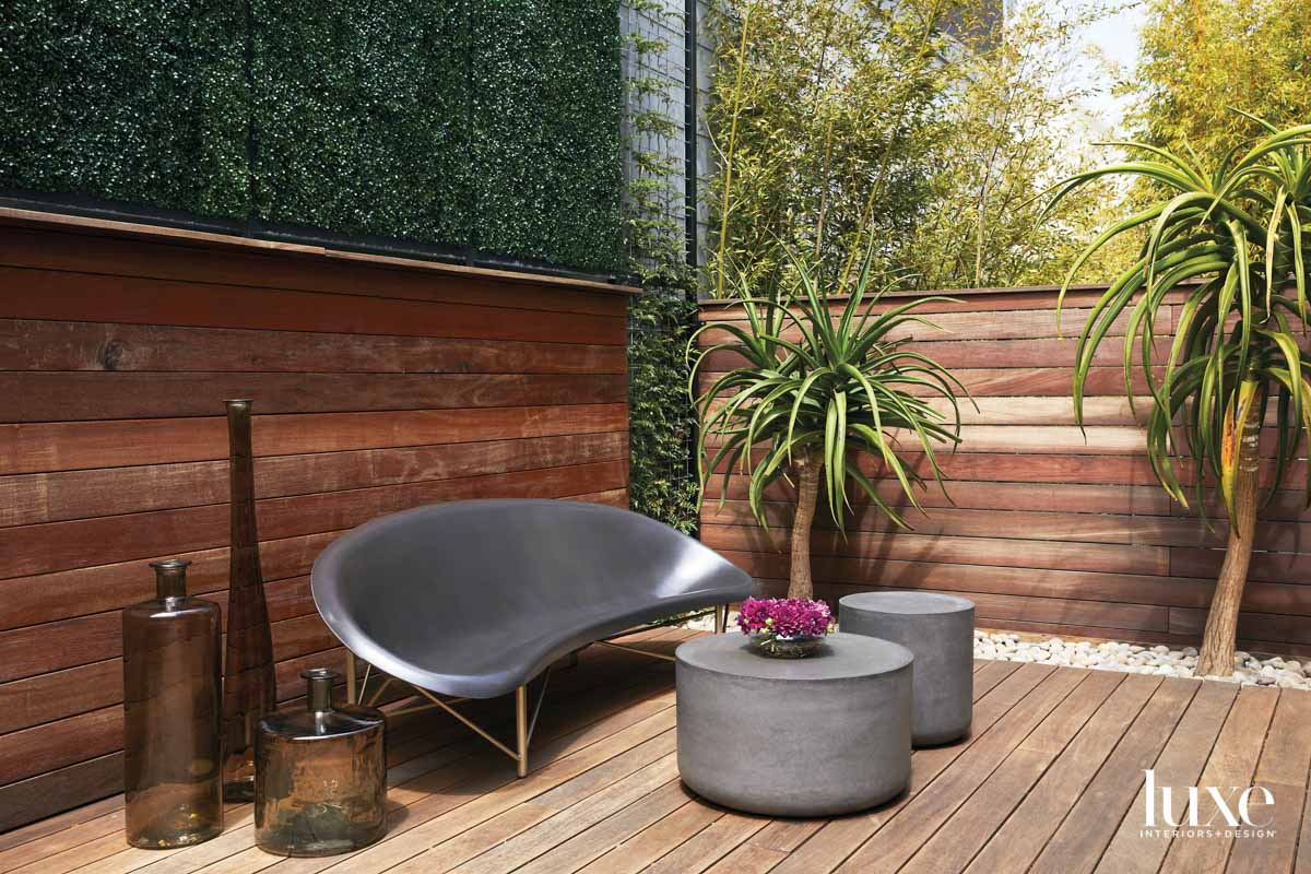 A deck features an oval...