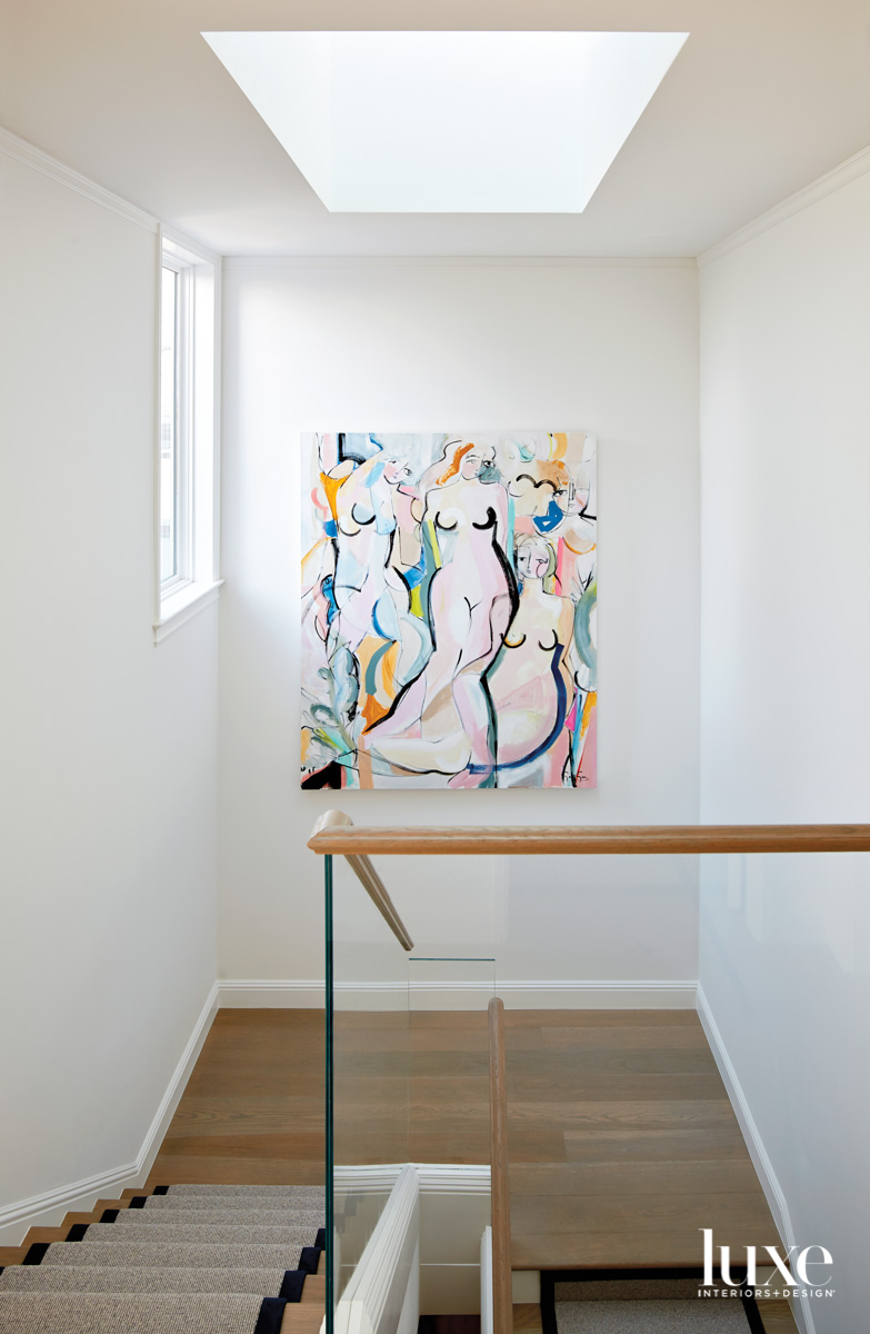 A painting hangs above a...