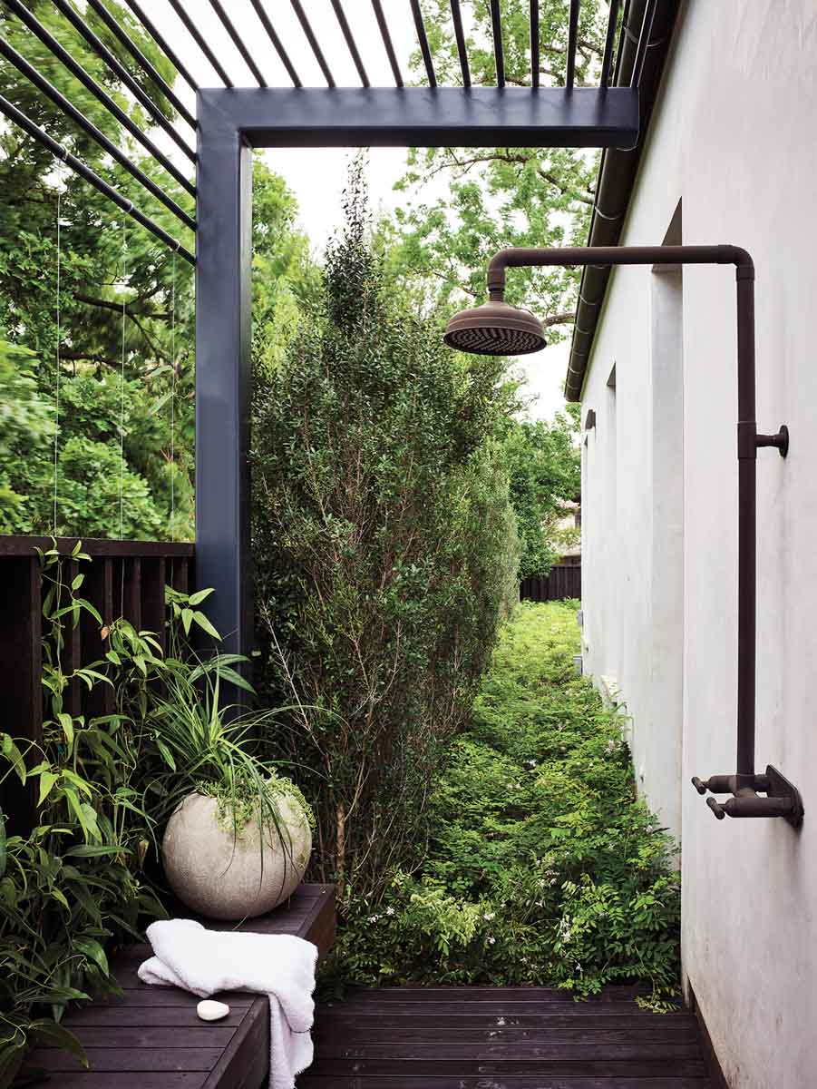Outdoor shower surrounded by plants
